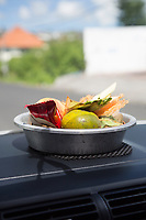 Bali, Indonesia.  A Canang, a Balinese Offering to the Gods, on the Dashboard of a Private Car.