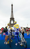07 JUL 2012 - PARIS, FRA - Poissy Triathlon team members wait to enter transition by the Tour de Eiffel to prepare for the start of the elite men's French Grand Prix round during the 2012 Triathlon de Paris at the Pont de Lena in Paris, France (PHOTO (C) 2012 NIGEL FARROW)
