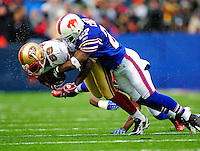 30 November 2008: San Francisco 49ers' wide receiver Jason Hill gains six yards and a first down before being tackled in the third quarter by Buffalo Bills' cornerback Reggie Corner at Ralph Wilson Stadium in Orchard Park, NY. The 49ers defeated the Bills 10-3. ***** Editorial Use Only ******..Mandatory Photo Credit: Ed Wolfstein Photo