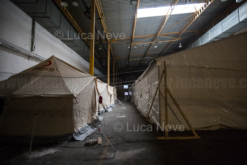 "Bihać, Bosanska Krajina, Bosnia, 15/12/2018.The Bira camp is a former fridge factory located outside Bihac. It is managed by the UN (ONU) agency called IOM (OIM) - International Organization for Migration. The camp is a huge hangar and it composed by tents and containers (mainly located in the area dedicated to most vulnerable people and families) 'donated' by the EU, Turkkizilayi, Crveni Kriz Grada Bihaca. The camp has got also a Health clinic, the ""Klinika"", provided by DRC Danish Refugee Council and UNHCR and EU (UE). The People met outside the Klinica who showed their medical refers, their wounds and injuries claimed that they were beaten up by the Croatian Police which also allegedly stole their money and broke their smartphones after they were found trying to cross the border between Bosnia & Croatia, the beginning of the so called ""The Game"" (1.). The very dangerous end of the ""Balkan route"", the undetected border crossing throughout Croatia and then Slovenia, which people try numerous times to reach Italy or Austria. If they caught crossing any of the borders, they will be deported back to Bosnia, at ""square 1 of the Game"".<br />