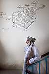 6 June 2013, Turahi Girls School, Mazar-i-Sharif, Afghanistan.  Member of the school shura council, Mohammad Ali on the school stair well at Turahi Girls High School in Mazar-i-Sharif.  The shura council has elders, teachers and students on it to make decisions regarding the future of the school. Much of the funding for the school including the construction of the main building was provided by  the Education Quality Improvement Program (EQUIP). The school is benefitting from EQUIP whose objective is to increase access to quality basic education, especially for girls. School grants and teacher training programs are strengthened by support from communities and private providers.  Picture by Graham Crouch/World Bank