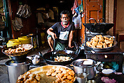 A sweet vendor in the ancient city of Varanasi in Uttar Pradesh, India. Photograph: Sanjit Das/Panos