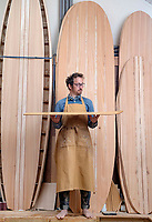 BNPS.co.uk (01202 558833)<br /> Pic: ZacharyCulpin/BNPS<br /> <br /> Pictured: James creates boards of all shapes and sizes, from longboards to the traditional body boards. <br /> <br /> Surf's up...<br /> <br /> The demand for sustainable wooden surfboards is on the rise - great news for carpenter James Otter who spends up to 80 hours on one of his beautiful handcrafted boards.<br /> <br /> James' company Otter Surfboards is the leading maker of wooden surfboards in the UK, if not Europe.<br /> <br /> He sources all his wood directly from woodlands in the south west and customers can even spend five days in his Cornish workshop learning how to make their own board.