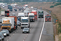 Fire engine racing down the hardshoulder to attend a road traffic accident, which has caused lenghty tailbacks of traffic due to lane closures...© SHOUT. THIS PICTURE MUST ONLY BE USED TO ILLUSTRATE THE EMERGENCY SERVICES IN A POSITIVE MANNER. CONTACT JOHN CALLAN. Exact date unknown.john@shoutpictures.com.www.shoutpictures.com..
