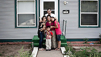 Guillermo Reyes, his wife Sandra and their children Yesenia, Alejandra and Jeremy in front of their house in Garden City, Kansas. They are from Salvador and Guillermo is one of the many migrants who have come to the town to work at the Tyson meat packing plant where he is also a part-time chaplain, administering to its employee's spiritual needs. Kansas dominates the American beef industry, producing 25% of all beef raised in the USA. However, the industry is heavily dependent on cheap immigrant labour.