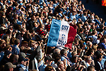 © Joel Goodman - 07973 332324 . 13/05/2012 .  Manchester , UK . Manchester City Football Club fans celebrate inside the Etihad Stadium after the result of their match against QPR ensures Manchester City wins the Premiership title . Photo credit: Joel Goodman