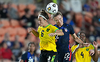 HOUSTON, TX - JUNE 13: Havana Solaun #6 of Jamaica and Kristie Mewis #22 of the United States battle for a head ball during a game between Jamaica and USWNT at BBVA Stadium on June 13, 2021 in Houston, Texas.