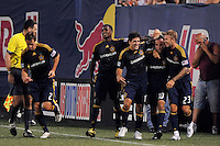 Landon Donovan (10) of the Los Angeles Galaxy celebrates scoring with teammates including Edson Buddle (14), Alecko Eskandarian (11), and David Beckham (23). The Los Angeles Galaxy defeated the New York Red Bulls 3-1 during a Major League Soccer match at Giants Stadium in East Rutherford, NJ, on July 16, 2009.