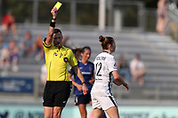 CARY, NC - SEPTEMBER 12: Olivia Moultrie #42 of the Portland Thorns FC is shown the yellow card by referee Matt Franz after kicking a dead ball away during a game between Portland Thorns FC and North Carolina Courage at Sahlen's Stadium at WakeMed Soccer Park on September 12, 2021 in Cary, North Carolina.
