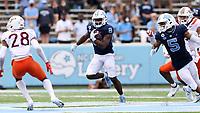 CHAPEL HILL, NC - OCTOBER 10: Michael Carter #8 of North Carolina rushes for 13 yards during a game between Virginia Tech and North Carolina at Kenan Memorial Stadium on October 10, 2020 in Chapel Hill, North Carolina.