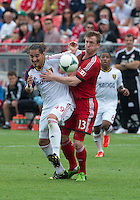 29 June 2013:  Toronto FC defender Steven Caldwell #13 and Real Salt Lake forward Devon Sandoval #49 in action during an MLS game between Real Salt Lake and Toronto FC at BMO Field in Toronto, Ontario Canada.