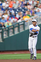 Florida Gators shortstop Richie Martin (12) makes a throw to first base against the Miami Hurricanes in the NCAA College World Series on June 13, 2015 at TD Ameritrade Park in Omaha, Nebraska. Florida defeated Miami 15-3. (Andrew Woolley/Four Seam Images)