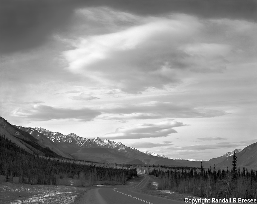 """""""The Alaska Highway"""" <br /> British Columbia, Canada <br /> <br /> The Alaska Highway begins in Canada's Dawson Creek, British Columbia and passes through Canada's Yukon Territory before arriving at its destination almost 1,400 miles later near Fairbanks, Alaska. This photo shows the Alaska Highway in northern BC just before crossing into the Yukon."""