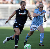 LA Sol defender Brittany Bock (11) dribbles the ball down the field while being pursued by Chicago Red Stars midfielder Frida Ostberg (18).  The Chicago Red Stars defeated the LA Sol 3-1 at Toyota Park in Bridgeview, IL on August 2, 2009.