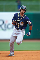 San Antonio Missions outfielder Alberth Martinez (21) running the bases during a game against the NW Arkansas Naturals on May 30, 2015 at Arvest Ballpark in Springdale, Arkansas.  San Antonio defeated NW Arkansas 5-2.  (Mike Janes/Four Seam Images)