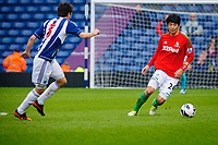 Saturday, 9 March 2013<br /> <br /> Pictured: Claudio Yacob of West Bromwich Albion goes to tackle Ki Sung-Yueng of Swansea City<br /> <br /> Re: Barclays Premier League West Bromich Albion v Swansea City FC  at the Hawthorns, Birmingham, West Midlands