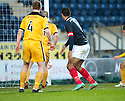 Falkirk's Lyle Taylor scores their first goal.