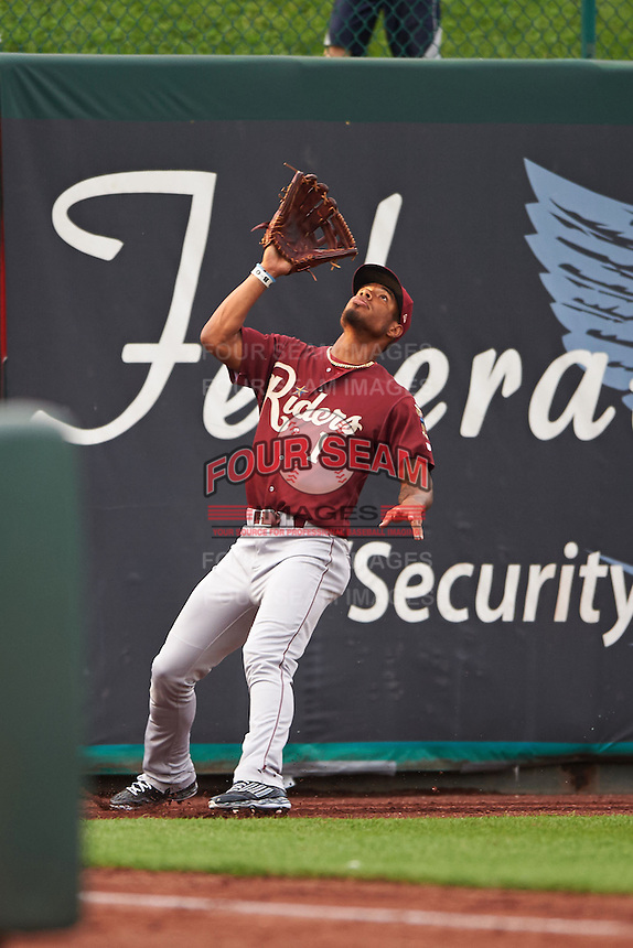 Frisco RoughRiders outfielder Nick Williams (1) catches a fly ball on the warning track during a game against the Springfield Cardinals on June 3, 2015 at Hammons Field in Springfield, Missouri.  Springfield defeated Frisco 7-2.  (Mike Janes/Four Seam Images)