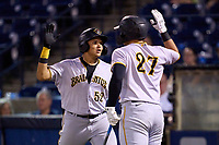 Bradenton Marauders Dariel Lopez (52) high fives Abrahan Gutierrez (27) after hitting a home run during Game Three of the Low-A Southeast Championship Series against the Tampa Tarpons on September 24, 2021 at George M. Steinbrenner Field in Tampa, Florida.  (Mike Janes/Four Seam Images)