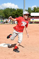 Young fans run the bases after a Batavia Muckdogs against the Mahoning Valley Scrappers on August 24, 2014 at Dwyer Stadium in Batavia, New York.  Mahoning Valley defeated Batavia 7-6.  (Mike Janes/Four Seam Images)