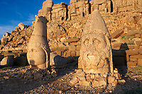 Pictures & Images of the statues of around the tomb of Commagene King Antochus 1 on the top of Mount Nemrut, Turkey. Stock photos & Photo art prints. In 62 BC, King Antiochus I Theos of Commagene built on the mountain top a tomb-sanctuary flanked by huge statues (8–9 m/26–30 ft high) of himself, two lions, two eagles and various Greek, Armenian, and Iranian gods. The photos show the broken statues on the  2,134 m (7,001 ft)  mountain. 3