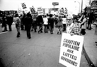 May 1, 1975 File Photo - Union Leaders Louis Laberge (FTQ), Marcel Pepin (CSN) and Yvon Charbonneau (CEQ) take part in the Worker's day march