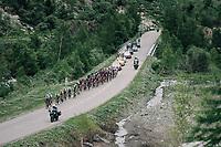 yellow jersey peloton up the snow-patched Cormet de Roselend (1977m) <br /> <br /> Stage 7: Moûtiers > Saint-Gervais Mont Blanc (129km)<br /> 70th Critérium du Dauphiné 2018 (2.UWT)