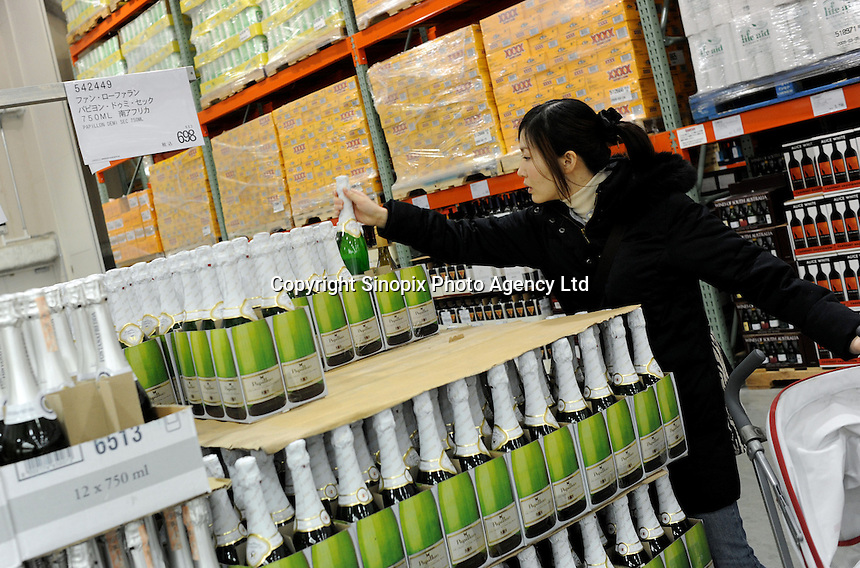 The wine department at a Costco outlet, Tokyo, Japan. Costco has seen a surge in customers, who are able to buy in bulk at wholesale prices, as the economy has taken a down-turn..