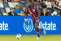 KANSAS CITY, KS - JULY 11: Shaq Moore #20 of the United States dribbles the ball during a game between Haiti and USMNT at Children's Mercy Park on July 11, 2021 in Kansas City, Kansas.