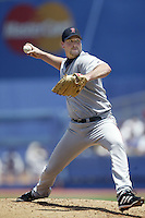 Derek Lowe of the Boston Red Sox pitches during a 2002 MLB season game against the Los Angeles Dodgers at Dodger Stadium, in Los Angeles, California. (Larry Goren/Four Seam Images)