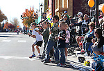 A group of boys react to a soldier float during the 75th annual Nevada Day parade in Carson City, Nev., on Saturday, Oct. 26, 2013.<br /> Photo by Cathleen Allison