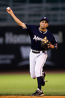 Jeff Bianchi (6) of the Northwest Arkansas Naturals throws to first during a game against the San Antonio Missions at Arvest Ballpark on June 30, 2011 in Springdale, Arkansas. (David Welker / Four Seam Images)