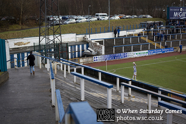 Greenock Morton 2 Stranraer 0, 21/02/2015. Cappielow Park, Greenock. Home supporters behind the goal watching on as Greenock Morton (in hoops) take on Stranraer in a Scottish League One match at Cappielow Park, Greenock. The match was between the top two teams in Scotland's third tier, with Morton winning by two goals to nil. The attendance was 1,921, above average for Morton's games during the 2014-15 season so far. Photo by Colin McPherson.