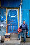 Chilean man holding sack of potatoes, Patagonia, South America