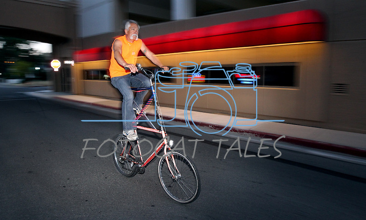 Eddie Fruend rides his home-made double-decker bike during the first annual Blinky Man event in downtown Carson City, Nev., on Wednesday, June 19, 2013.<br /> Photo by Cathleen Allison