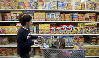 A Wal-Mart customer peruses the cereal aisle Thursday, March 2, 2006, in Grove City, Ohio.<br />