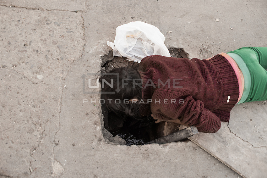 A child looks for rubbish to recycle in sewers. Tijuana, Mexico. Jan 06, 2015.