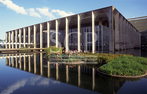 Brasilia, Brazil. Palace of Itamaraty (Foreign Ministry) by Oscar Niemeyer (architect) reflected in the pond which surrounds it.