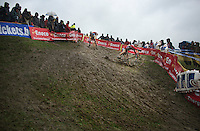 Kevin Pauwels (BEL) crashes out on the slippery descent<br /> <br /> Bpost Bank Trofee - GP Mario De Clerq 2013