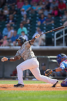 Courtney Hawkins (10) of the Birmingham Barons follows through on his swing against the Tennessee Smokies at Regions Field on May 3, 2015 in Birmingham, Alabama.  The Smokies defeated the Barons 3-0.  (Brian Westerholt/Four Seam Images)