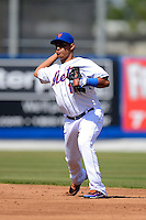 New York Mets shortstop Ruben Tejada #11 during an exhibition game against the Michigan Wolverines at Tradition Field on February 24, 2013 in St. Lucie, Florida.  New York defeated Michigan 5-2.  (Mike Janes/Four Seam Images)
