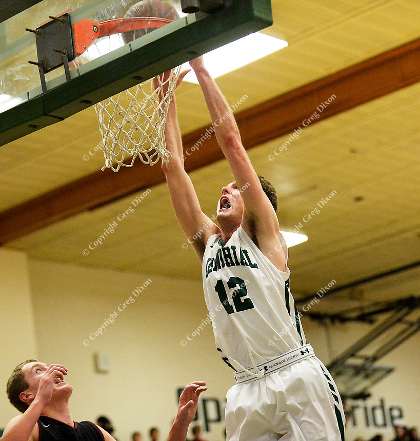 Memorial's Matt Caropreso finishes a layup during the first half of the Big Eight Conference boys basketball game between Middleton and Madison Memorial on Thursday at Memorial High School in Madison
