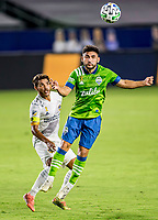 CARSON, CA - SEPTEMBER 27: Cristian Roldan #7 of the Seattle Sounders heads a ball during a game between Seattle Sounders FC and Los Angeles Galaxy at Dignity Heath Sports Park on September 27, 2020 in Carson, California.