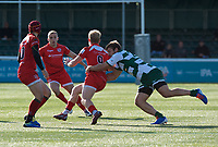 Will Homer of Jersey Reds is tackled by Pat Howard of Ealing Trailfinders during the Greene King IPA Championship match between Ealing Trailfinders and Jersey at Castle Bar, West Ealing, England  on 19 October 2019. Photo by Alan Stanford / PRiME Media Images