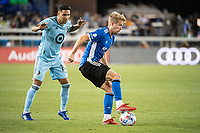 SAN JOSE, CA - AUGUST 17: Jackson Yueill #14 of the San Jose Earthquakes dribbles the ball during a game between San Jose Earthquakes and Minnesota United FC at PayPal Park on August 17, 2021 in San Jose, California.