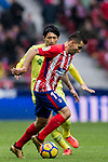 Angel Correa (R) of Atletico de Madrid battles for the ball with Gaku Shibasaki of Getafe CF during the La Liga 2017-18 match between Atletico de Madrid and Getafe CF at Wanda Metropolitano on January 06 2018 in Madrid, Spain. Photo by Diego Gonzalez / Power Sport Images