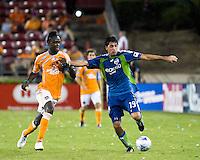 Seattle Sounders defender Leo Gonzalez (19) holds off Houston Dynamo forward Kei Kamara (10).  Houston Dynamo tied Seattle Sounders 1-1 on August 23, 2009 at Robertson Stadium in Houston, TX.