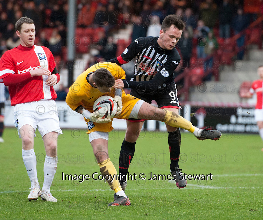 Ayr keeper David Hutton saves from Par's Lawrence Shankland.