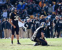 Pitt kicker Dan Hutchins (30) gets ready to make a kick. The WVU Mountaineers defeated the Pitt Panthers 35-10 at Heinz Field, Pittsburgh, Pennsylvania on November 26, 2010.