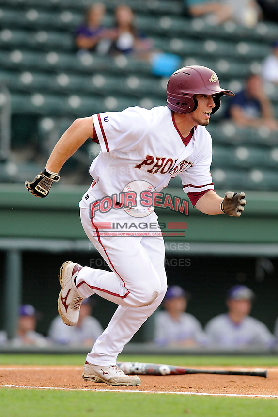 Right fielder Quinn Bower (28) of the Elon Phoenix runs to first in a game against the Furman Paladins in a first-round Southern Conference playoffs game on Wednesday, May 22, 2013, at Fluor Field at the West End in Greenville, South Carolina. Furman won, 10-1. (Tom Priddy/Four Seam Images)